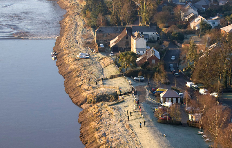 To witness the Severn Bore from the air is like nothing else. One can really appreciate the topography of the river as it channels the huge wave down the estuary and into the narrow sections upstream. The wave takes on many shapes and characteristics that just cannot be appreciated from the ground. It is a great vantage point to see the gravity waves. Most people perceive the bore to be a single wave. Check the images and dispel that myth. Crowds watching from river side in the freezing cold. Olympus E3, 50-200mm SWD