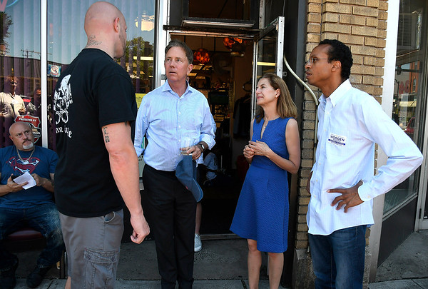 7/7/2018 Mike Orazzi   Staff John Tierpack talks with Democratic Governor candidate Ned Lamont, Lt. Governor candidate Susan Bysiewicz and Shawn Wooden, candidate for Connecticut State Treasurer during a walking tour of Broad Street in New Britain Saturday.