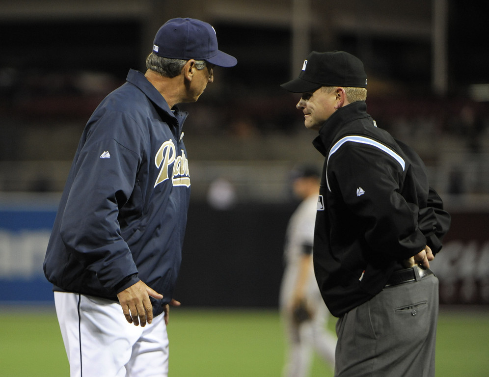 . SAN DIEGO, CA - APRIL 12:  Manager Bud Black #20 of the San Diego Padres argues a call with first base umpire Mike Muchlinski in the fifth inning against the Colorado Rockies at Petco Park on April 12, 2013 in San Diego, California.  (Photo by Denis Poroy/Getty Images)