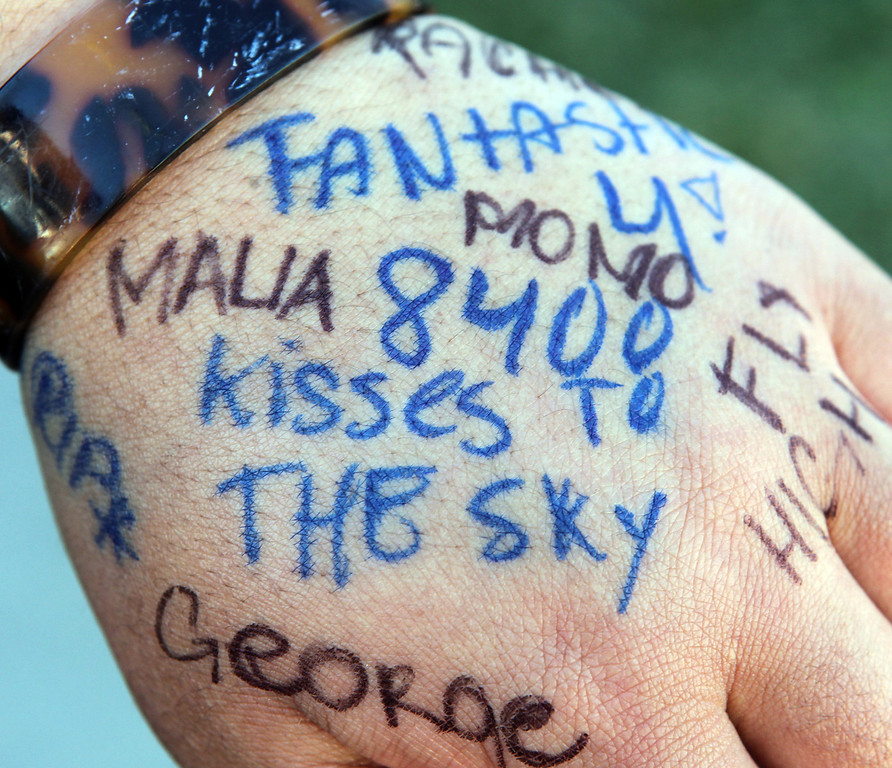 . Moala Halatoa, 16, a student at Castlemont High School and cousin of four teens George Moa, 19, David Moa, 19, Malia Moa, 19, and Rachel Fisi\'iahi, 17, who all died in a car accident shows the messages written on her hand in their honor outside as school let out in Oakland, Calif., on Thursday, Feb. 14, 2013. Family, friends, classmates and staff attended a memorial service at the school for the four teens. (And a Chu/Staff)