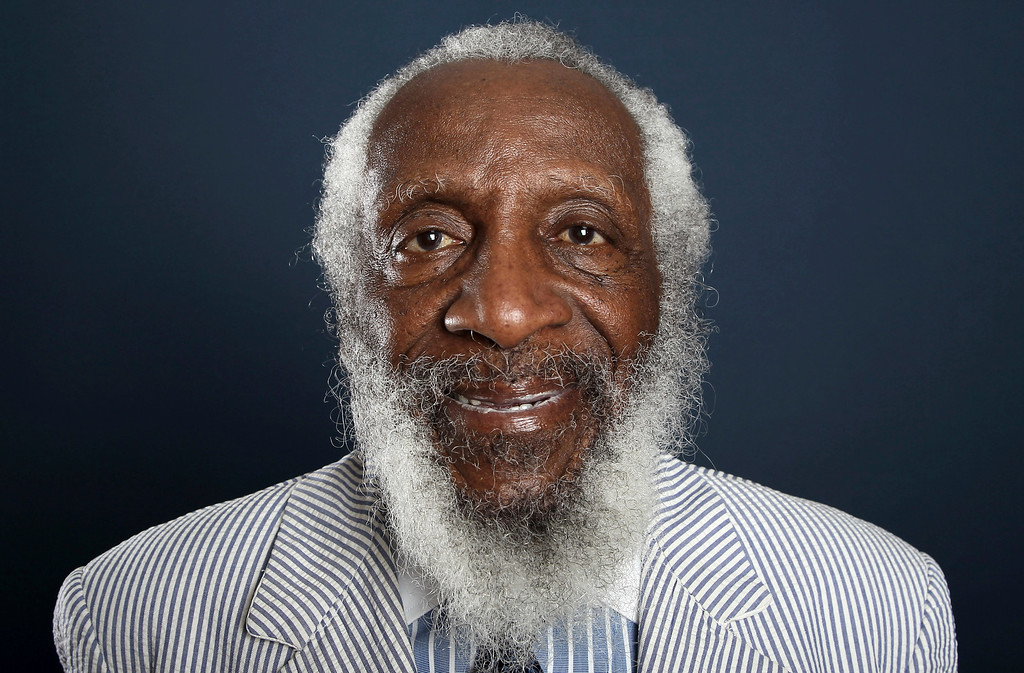 . FILE - In this July 21, 2012 file photo, comedian and activist Dick Gregory poses for a portrait during the PBS TCA Press Tour in Beverly Hills, Calif. Gregory, the comedian and activist and who broke racial barriers in the 1960s and used his humor to spread messages of social justice and nutritional health, has died. He was 84. Gregory died late Saturday, Aug. 19, 2017, in Washington, D.C. after being hospitalized for about a week, his son Christian Gregory told The Associated Press. He had suffered a severe bacterial infection. (Photo by Matt Sayles/Invision/AP, File)