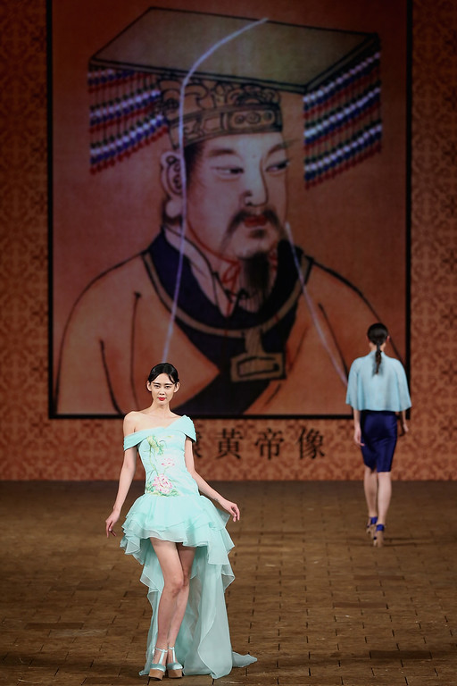 . A model showcases designs by Zhang Zhifeng on the runway at 2015 NE-TIGER Haute Couture Collection show during Mercedes-Benz China Fashion Week Spring/Summer 2015 at Beijing Hotel on October 25, 2014 in Beijing, China.  (Photo by Feng Li/Getty Images)