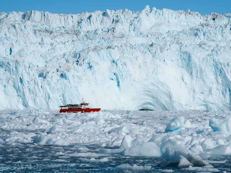 Boat at Eqi Glacier in Greenland