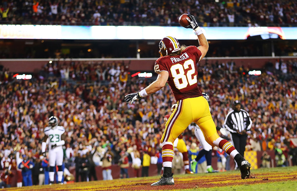 Description of . Logan Paulsen #82 of the Washington Redskins celebrates his first quarter touchdown against the Seattle Seahawks during the NFC Wild Card Playoff Game at FedExField on January 6, 2013 in Landover, Maryland.  (Photo by Al Bello/Getty Images)