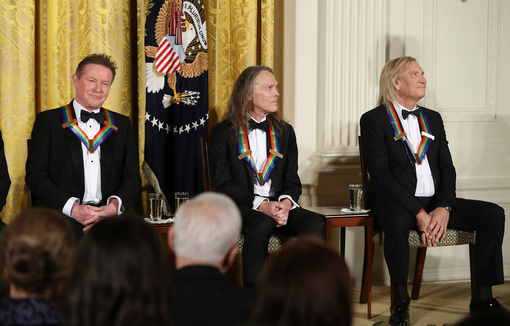 . The recipients of the 2016 Kennedy Center Honors, members of the rock band the Eagles, from left, Don Henley, Timothy Schmit, and Joe Walsh are recognized during a reception in their honor in the East Room of the White House in Washington, Sunday, Dec. 4, 2016, hosted by President Barack Obama and first lady Michelle Obama. (AP Photo/Manuel Balce Ceneta)