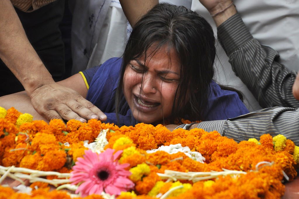 . A relative of an Indian victim of the Nepalese earthquake mourns as their body is brought from Kathmandu to the airport in Guwahati on April 29, 2015. A total of 5,057 people are so far known to have died in Nepal and around 100 more in neighbouring India and China after the earthquake struck on April 25.  AFP Photo/ Biju BORO/AFP/Getty Images