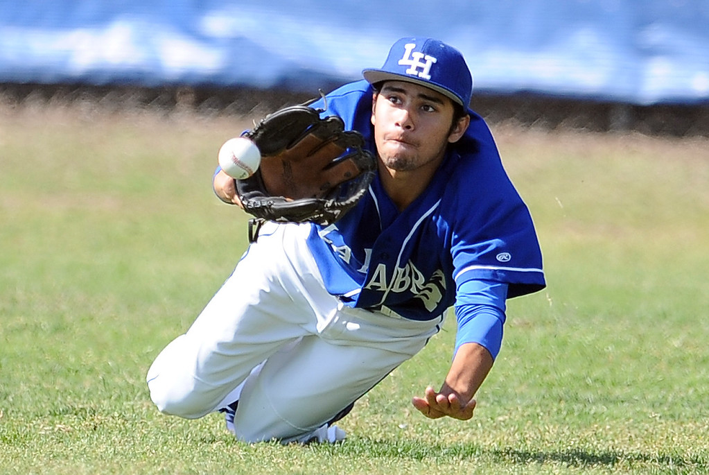 . La Habra right fielder Andrew Gallegos dives for a drive by Bonita\'s Joe Quire (not pictured) in the second inning of a prep baseball game at La Habra High School on Tuesday, April 2, 2013 in La Habra, Calif. Bonita won 8-2.  (Keith Birmingham Pasadena Star-News)