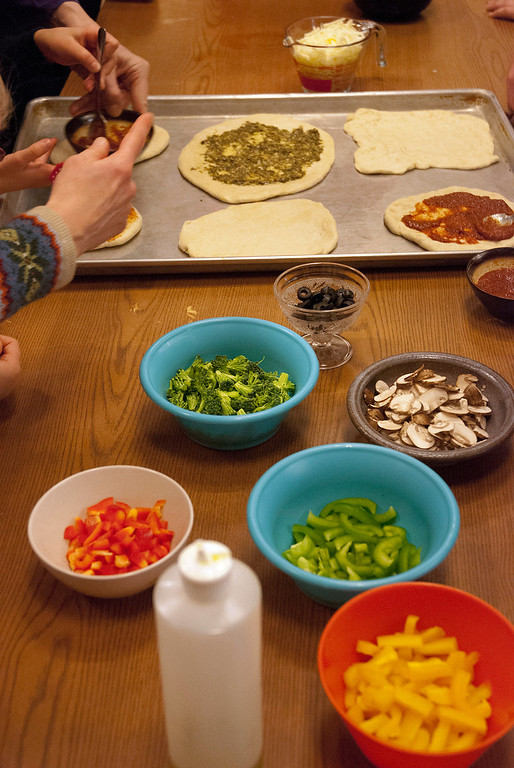 . Kayla Rice/Reformer Children were able to cover their pizza crusts with whichever toppings they desired during a cooking class held at the Brattleboro Food Co-Op for the Winter Carnival on Friday afternoon.