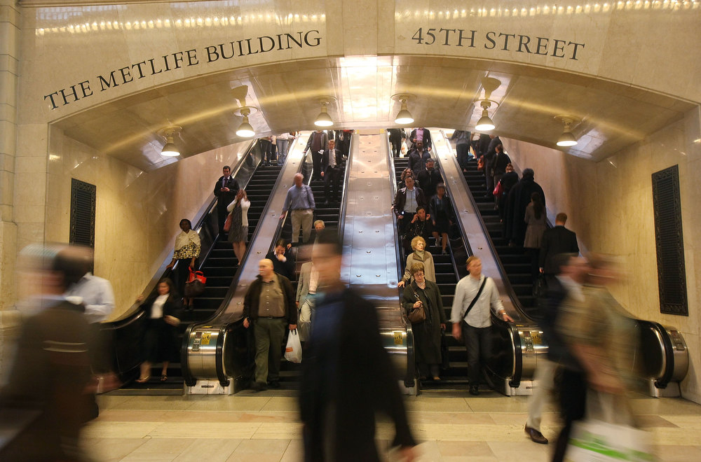 Description of . Commuters pass through Grand Central Terminal during the evening rush hour May 19, 2010 in New York City. (Photo by Mario Tama/Getty Images)