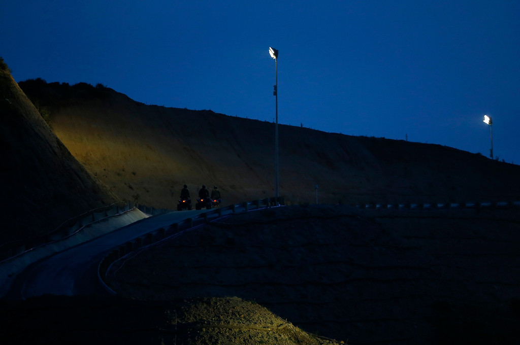 . U.S. Customs and Border Patrol agents patrol after dusk along the international border between Mexico and the United States near San Diego, California, March 26, 2013. Picture taken March 26, 2013. REUTERS/Mike Blake
