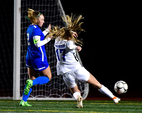 11/23/2019 Mike Orazzi | Staff Southington High School's Jordan Beaudoin (2) and Glastonbury's Samantha Forrest (17) during the Class LL Girls State Soccer Tournament at Veterans Stadium in New Britain Saturday evening. Glastonbury won 1-0.