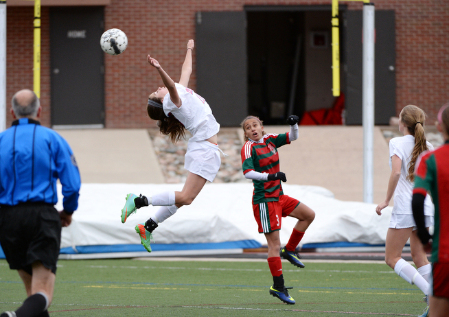 . Devon Peterson of Cherry Creek High School (19), top left, and Shanna Trott of Smoky Hill High School (3) are fighting for the control of free ball in the air during the 1st half of the game at Stutler Bowl Stadium. Greenwood Village. Colorado. April 29. 2014. Cherry Creek won 3-0. (Photo by Hyoung Chang/The Denver Post)