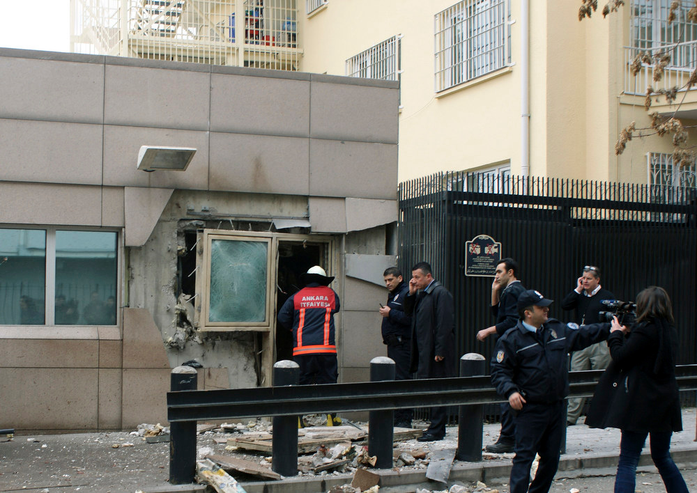 . Gate 2 of the embassy just after a suicide bomber detonated an explosive device at the entrance of the U.S. Embassy in the Turkish capital, Ankara, Turkey, Friday, Feb. 1, 2013. A suspected suicide bomber detonated an explosive device at the entrance of the U.S. Embassy in the Turkish capital on Friday, killing himself and one other person, officials said.  (AP Photo/IHA)
