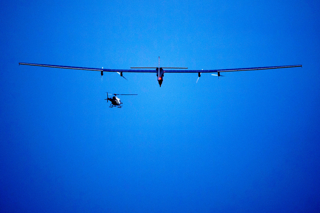 . The solar-powered Solar Impulse 2 aircraft is airborne during its first flight Monday, June 2, 2014 in Payerne, Switzerland.   (AP Photo/Fabrice Coffrini, pool)