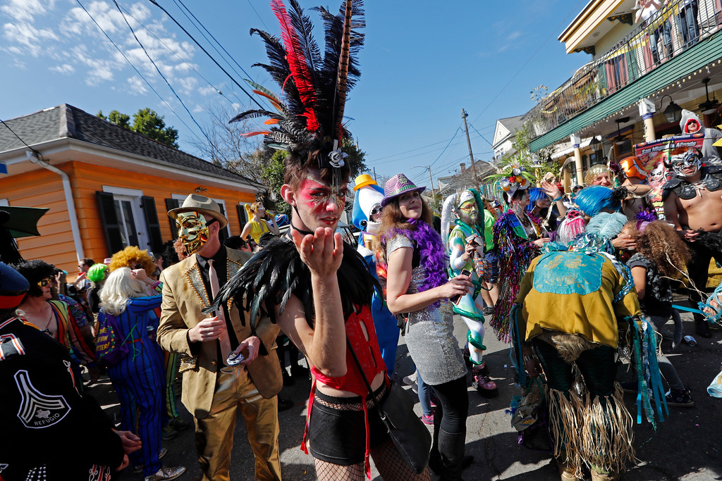 . A reveler blows a kiss to the camera during the Society de Sainte Anne parade, on Mardi Gras day in New Orleans, Tuesday, Feb. 13, 2018. (AP Photo/Gerald Herbert)