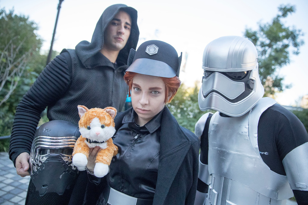 ". Ken Langsdorf, left, dressed as Kylo Ren, Allison Hill, center, dressed as General Hux, and Matt Langsdorf dressed as Captain Phasma from ""Star Wars: The Force Awakens\"" pose for a photo on their way Comic Con, Friday, Oct. 7, 2016, in New York. Comic Con runs through Oct. 9. (AP Photo/Mary Altaffer)"