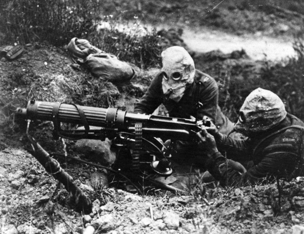 . Today marks the centenary of the outbreak of World War I, when Austria-Hungary declared war on Serbia, beginning a conflict that would claim over 16 million lives. Gas-masked men of the British Machine Gun Corps with a Vickers machine gun during the first battle of the Somme.   (Photo by General Photographic Agency/Getty Images)