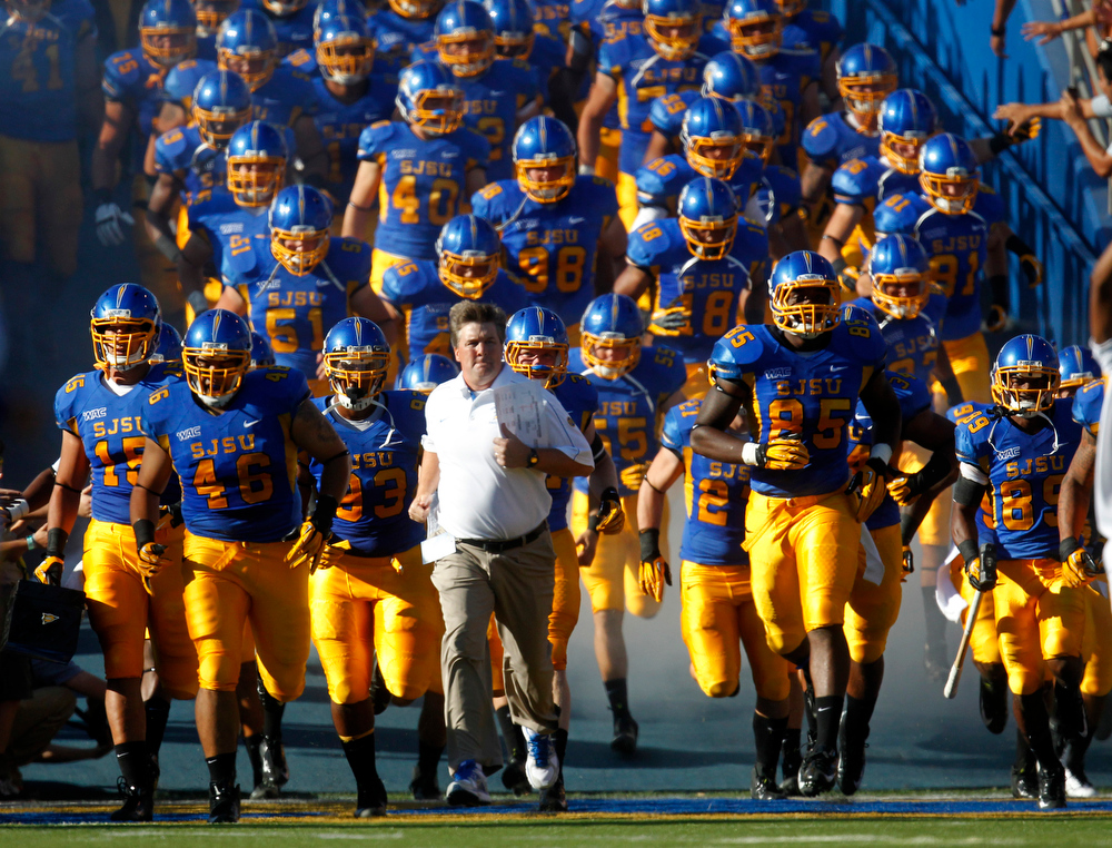 . San Jose State University Spartans head coach Mike MacIntyre leads his team onto the field before their game against the Colorado State University Rams at Spartan Stadium in San Jose, Calif. on Saturday, Sept. 15, 2012.  (Nhat V. Meyer/Staff)