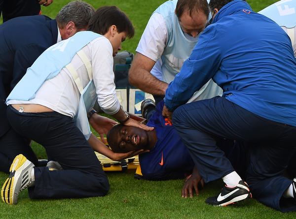. Netherlands\' defender Bruno Martins Indi is put on a stretcher by medical staff during a Group B football match between Australia and the Netherlands at the Beira-Rio Stadium in Porto Alegre during the 2014 FIFA World Cup on June 18, 2014. (LUIS ACOSTA/AFP/Getty Images)