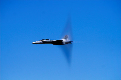 Fighter jet breaking the sound barier
