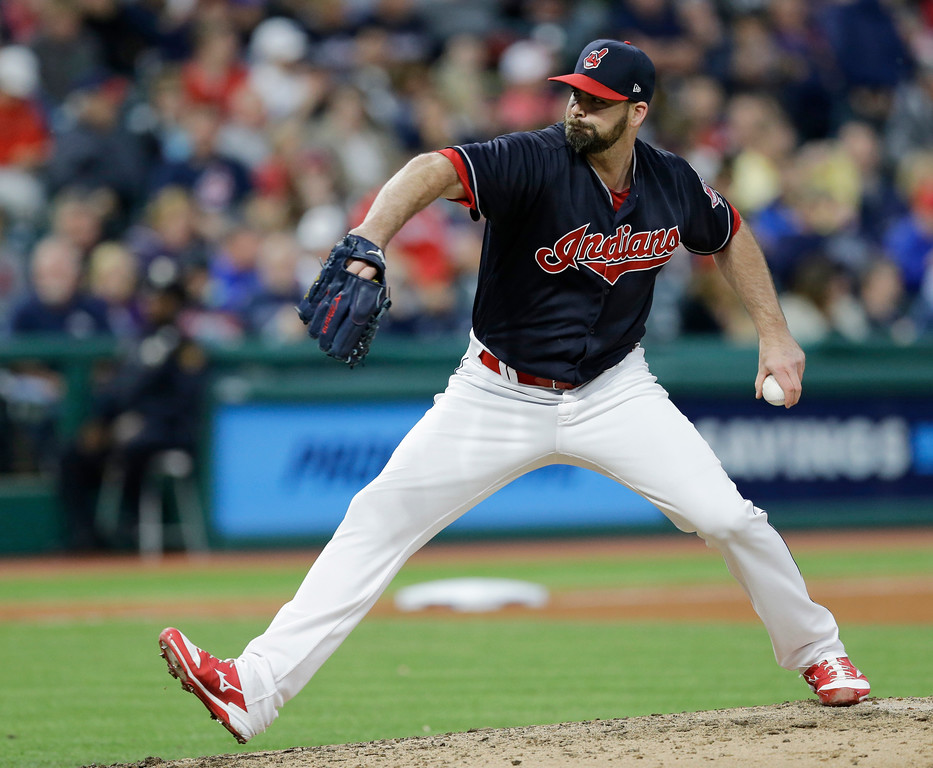 . Cleveland Indians relief pitcher Boone Logan delivers in the sixth inning of a baseball game against the Kansas City Royals, Friday, May 26, 2017, in Cleveland. (AP Photo/Tony Dejak)