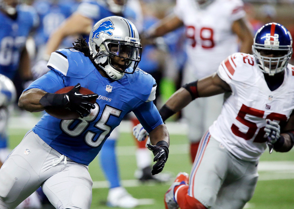 . Detroit Lions running back Joique Bell (35) is chased by New York Giants middle linebacker Jon Beason (52) during the third quarter of an NFL football game in Detroit, Sunday, Dec. 22, 2013. (AP Photo/Duane Burleson)