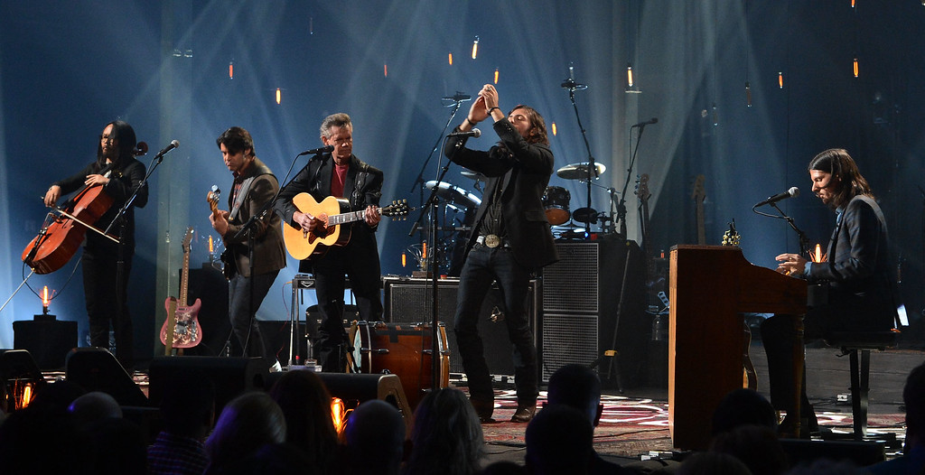 . FRANKLIN, TN - OCTOBER 24:  Joe Kwon - Avett Brothers, Bob Crawford - Avett Brothers, Randy Travis, Scott Avett and Seth Avett perform during CMT Crossroads: The Avett Brothers And Randy Travis tape at The Factory, Liberty Hall in Franklin, Tennessee on October 24, 2012     (Photo by Rick Diamond/Getty Images for CMT Crossroads)