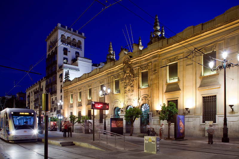 Tram in front of Correos Building, Seville, Spain