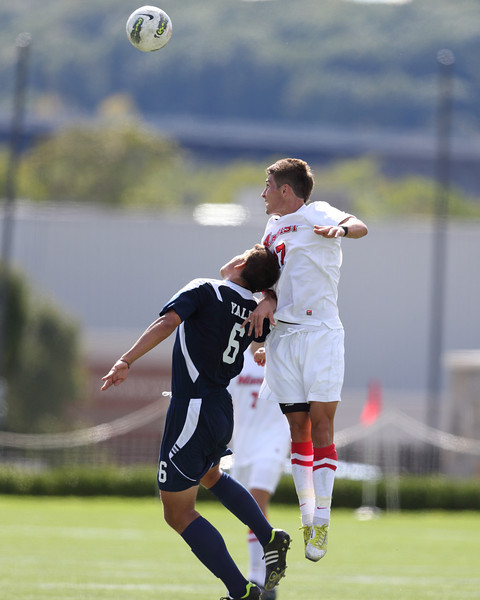 POUGHKEEPSIE, NY - SEPTEMBER 23: Josh Faga #17 out jumps Yale Bulldogs Pablo Espinola #6 to head ball during Yale verses Marist Soccer on September 23, 2012 at Tenney Stadium in Poughkeepsie New York.  Yale defeats Marist 2-1. (Photo by Sandy Tambone)