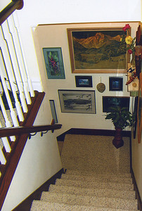 """""""Like so many old houses from the 19th century, the stairwell was really narrow, and it needed a lot of work,"""" Darling said.  Both the existing stairwell and a new one to the basement were widened to 42"""" to help improve access and egress, and to better accommodate moving furniture up and down the stairs.  Notice here the new landing added between the main floor and the upstairs.  Zana's flair for attractive artwork and accessories complemented the meticulous interior work.  You can click on any of these photos to select from a menu of size options at the top of the page."""