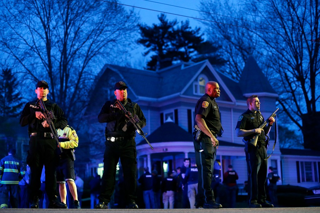 . In this Friday, April 19, 2013 file photo, police officers guard the entrance to Franklin Street where there is an active crime scene search for the suspect in the Boston Marathon bombings in Watertown, Mass. (AP Photo/Matt Rourke)