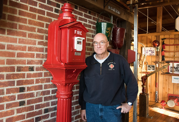 01/03/19 Wesley Bunnell | Staff Retired Bristol Fire Department Lt. Mark Redman stands in front of a Gamewell fire alarm box, # 73, which was previously used at the old Bristol High School / Memorial Boulevard School location.