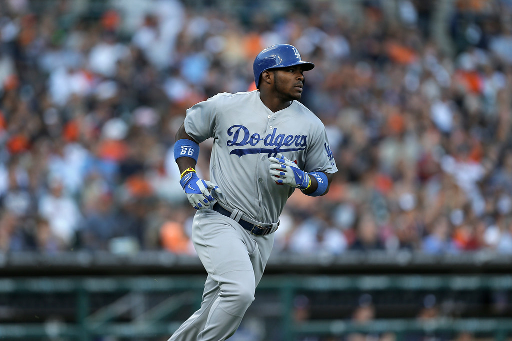 . Los Angeles DodgersYasiel Puig runs to first base against the Detroit Tigers in the second inning of a baseball game in Detroit, Tuesday, July 8, 2014. (AP Photo/Paul Sancya)