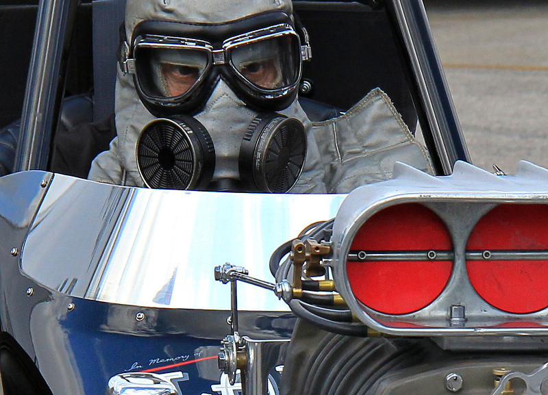 """The courage of those who drove front motored, nitro burning dragsters cannot be overstated. They sat with the differential between their legs and the explosive clutch between their ankles. All it took was a fuel-filled cylinder, hung intake valve or a bolt failure to cause a violently exploding engine, blasting them in the face with heavy shrapnel and burning fuel. Nitro engines don't break-they detonate. The lack of good fireproofing technology left drivers at high risk. They took it in stride-even with a sense of humor. My favorite driver quote-""""After the third flip, I lost control""""."""