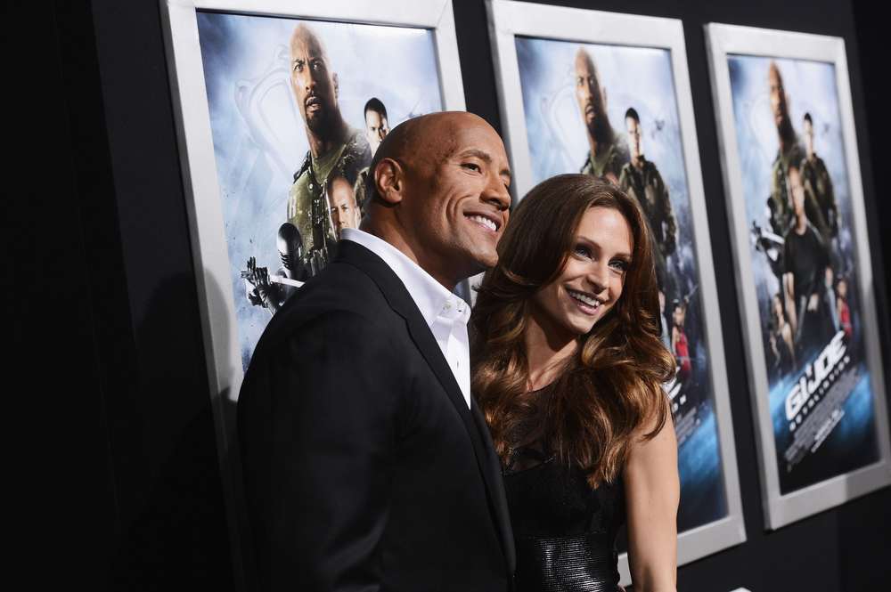 ". Actor Dwayne Johnson and Lauren Hashian attend the premiere of Paramount Pictures\' ""G.I. Joe:Retaliation\"" at TCL Chinese Theatre on March 28, 2013 in Hollywood, California.  (Photo by Kevin Winter/Getty Images)"