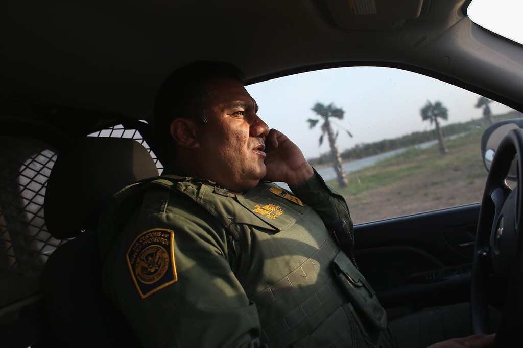 . MCALLEN, TX - APRIL 10:  U.S. Border Patrol agent Sal De Leon patrols near the U.S.-Mexico border on April 10, 2013 in McAllen, Texas. According to the Border Patrol, undocumented immigrant crossings have increased more than 50 percent in Texas\' Rio Grande Valley sector in the last year. Border Patrol agents say they have also seen an additional surge in immigrant traffic since immigration reform negotiations began this year in Washington D.C. Proposed refoms could provide a path to citizenship for many of the estimated 11 million undocumented workers living in the United States.  (Photo by John Moore/Getty Images)