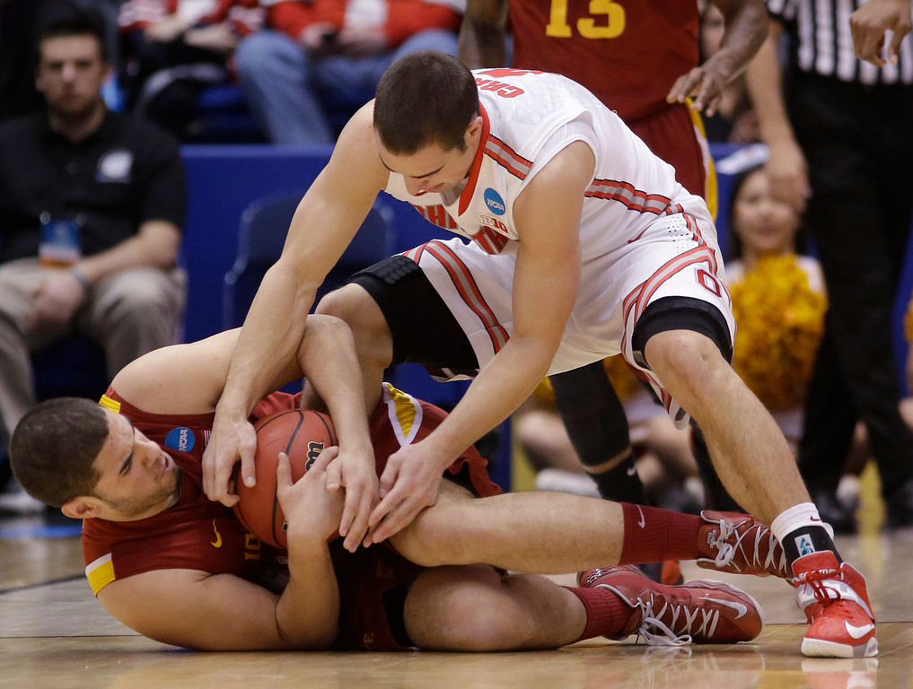 . Iowa State forward Georges Niang, bottom, and Ohio State guard Aaron Craft struggle over a loose ball in the first half of a third-round game of the NCAA college basketball tournament Sunday  March 24, 2013, in Dayton, Ohio. (AP Photo/Al Behrman)