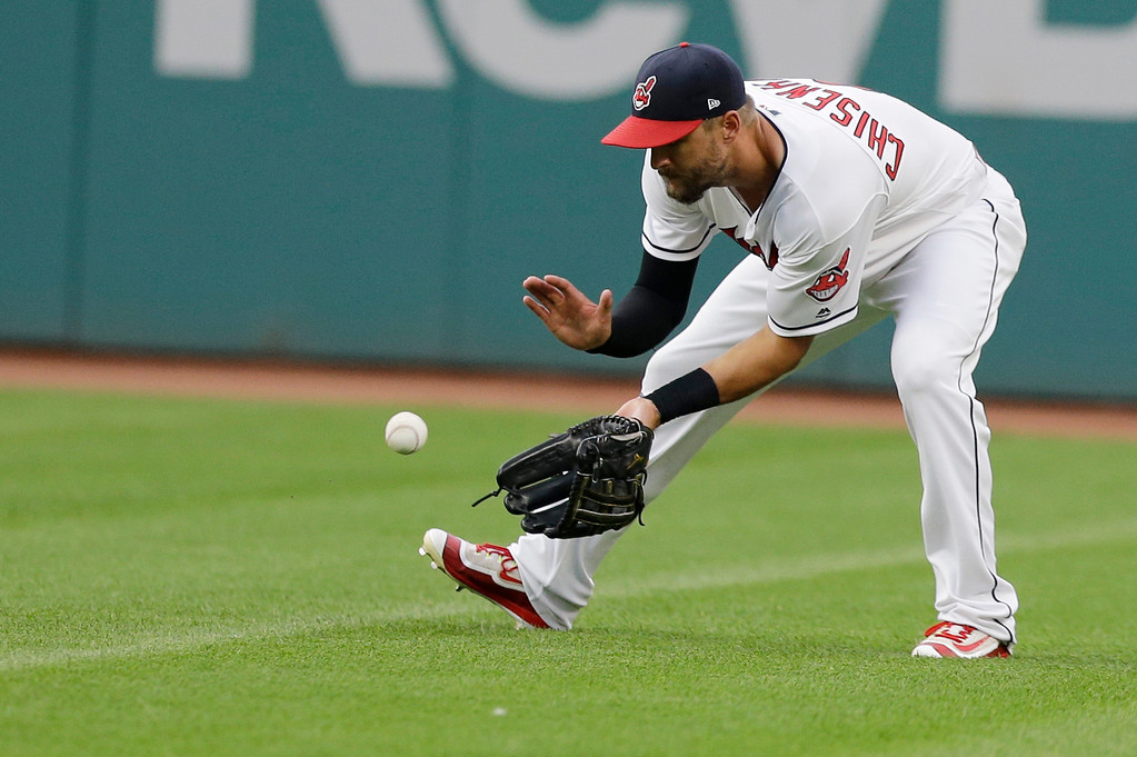 . Cleveland Indians\' Lonnie Chisenhall fields a ball hit by San Diego Padres\' Luis Torrens in the fifth inning of a baseball game, Wednesday, July 5, 2017, in Cleveland. Torrens was safe at first base. (AP Photo/Tony Dejak)