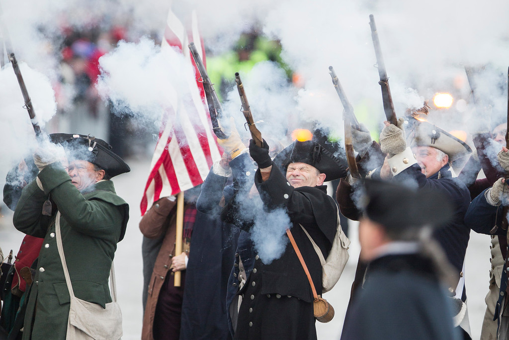 ". The New England Patriots ""End Zone Militia\"" fire their weapons during the New England Patriots victory parade on February 4, 2015 in Boston, Massachusetts. (Photo by Scott Eisen/Getty Images)"