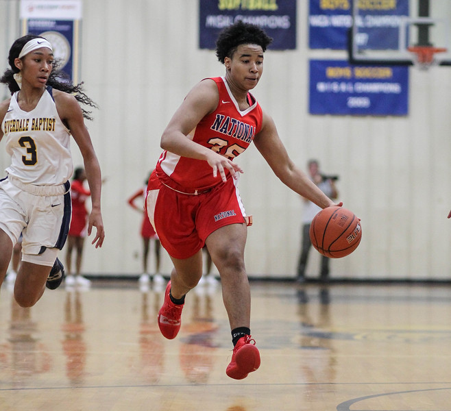 """January 31, 2019: National Christian forward Promise Cunningham (35) drives to the basket during HS girls basketball action between National Christian Academy and Riverdale Baptist in Upper Marlboro. Photo by: Chris Thompkins/Prince George""""s Sentinel"""
