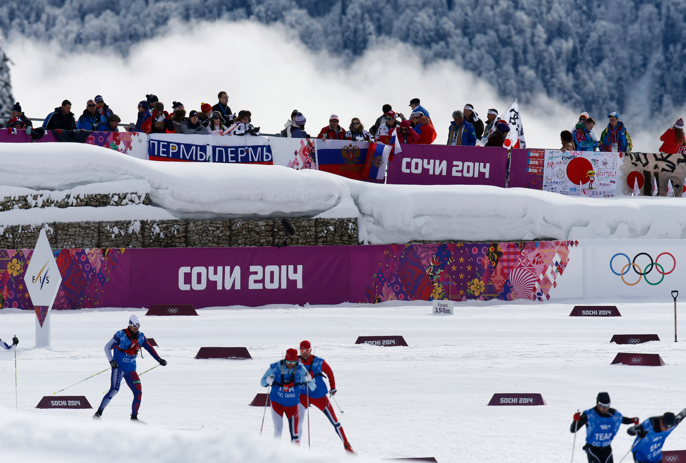 . Clouds come up from the valley during the preparations for the cross-country team sprint competitions at the 2014 Winter Olympics, Wednesday, Feb. 19, 2014, in Krasnaya Polyana, Russia. (AP Photo/Dmitry Lovetsky)