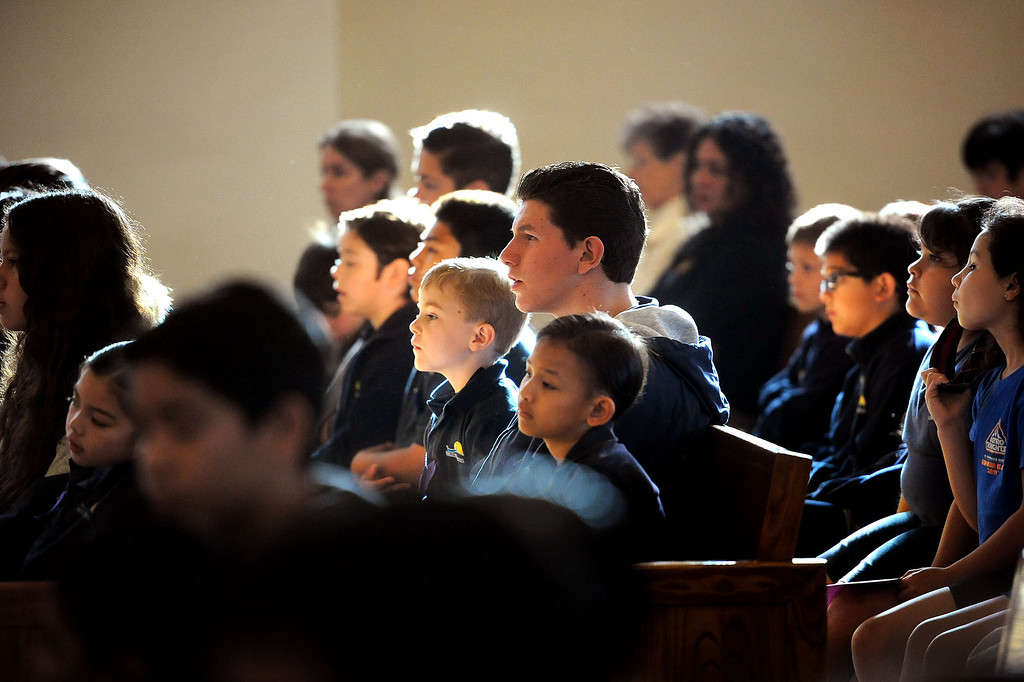 . Students from the Saint Euphrasia Roman Catholic School look on during the Ash Wednesday Mass at the Saint Euphrasia Catholic Church in Granada Hills, CA March 5, 2014.(Andy Holzman/Los Angeles Daily News)