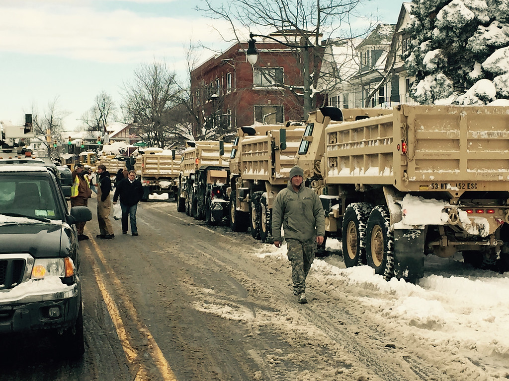 . In this photo released by the New York National Guard, New York Army National Guard dump trucks line up on West Seneca Street, Thursday, Nov. 20, 2014, in Buffalo, N.Y., to help clear snow from the city. A new blast of lake-effect snow pounded Buffalo for a third day piling more misery on a city already buried by an epic, deadly snowfall that could leave some areas with nearly 8 feet of snow on the ground when it\'s all done. (AP Photo/New York National Guard, Maj. Mark Frank)