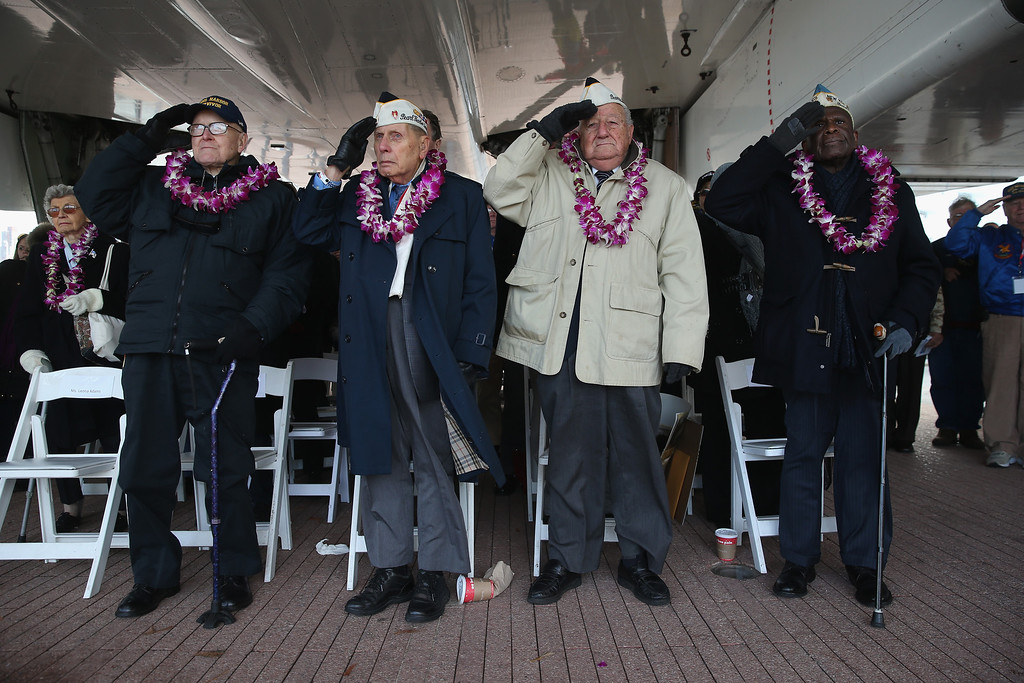 . Pearl Harbor survivors salute during the U.S. national anthem at a ceremony marking the 72nd anniversary of the attack on Pearl Harbor, Hawaii on December 7, 2013 in New York City. Four Pearl Harbor survivors from the New York area gathered with former crew members of the USS Intrepid to mark the Japanese surprise attack on December 7, 1941 which killed 2,402 Americans and brought the United States into WWII.  (Photo by John Moore/Getty Images)