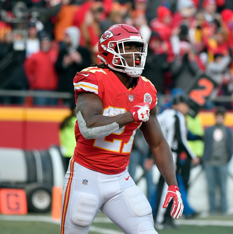 . Kansas City Chiefs running back Kareem Hunt (27) celebrates his one-yard touchdown during the first half of an NFL wild-card playoff football game against the Tennessee Titans, in Kansas City, Mo., Saturday, Jan. 6, 2018. (AP Photo/Ed Zurga)
