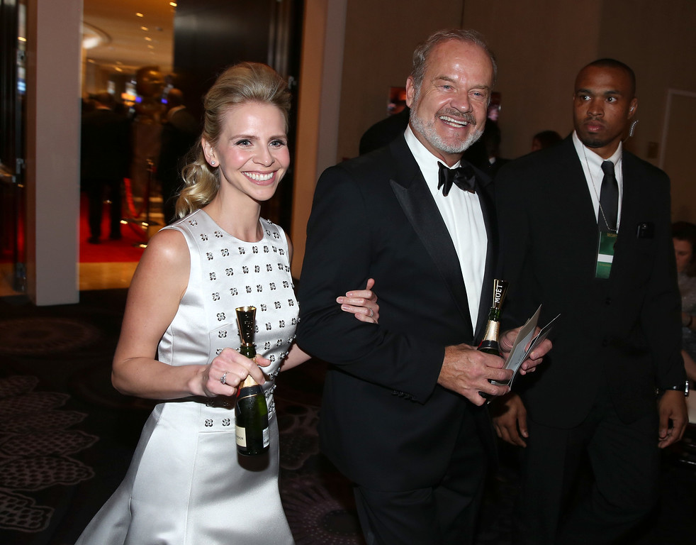 . Kayte Walsh, left, and Kelsey Grammer walk in the audience at the 72nd annual Golden Globe Awards at the Beverly Hilton Hotel on Sunday, Jan. 11, 2015, in Beverly Hills, Calif. (Photo by Matt Sayles/Invision/AP)