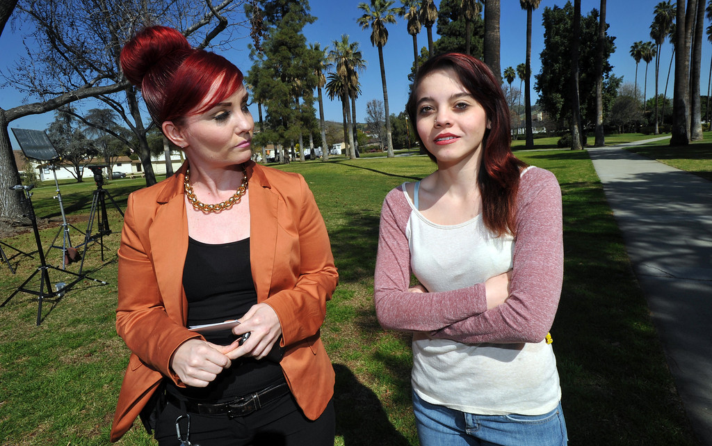 . Rose Marie Hernandez, 17, right, stands with her mother Jessica Blanco as she recounts a February 5th incident where a man tried to kidnap her as she was walking on Broadway Street near Founders Park. Whittier police officers have responded to several calls on cars matching the suspect vehicle on Friday February 22, 2013. (SGVN/Staff Photo by Keith Durflinger)