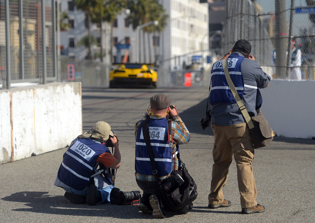 . Photographers capture the action during practice for the TUDOR Championship in Long Beach, CA on Friday, April 17, 2015. The 40th annual Toyota Grand Prix of Long Beach kicked off with practices for all of the racing divisions. (Photo by Scott Varley, Daily Breeze)