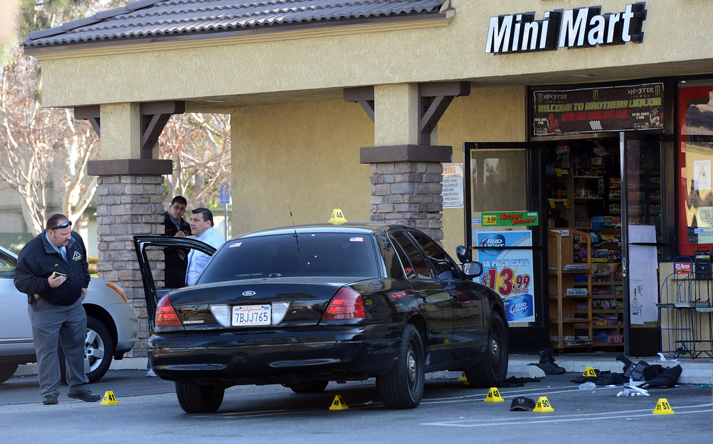 . San Bernardino County sheriff�s investigate the scene where a security guard was shot and later died during a robbery at a mini market Saturday night in the 10000 block of Arrow Highway in Rancho Cucamonga, CA., Sunday, February 23, 2014. (Photo by Jennifer Cappuccio Maher/Inland Valley Daily Bulletin)