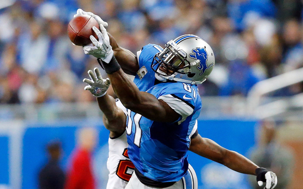 . Detroit Lions wide receiver Calvin Johnson (81), defended by Tampa Bay Buccaneers cornerback Johnthan Banks, catches a 21-yard reception during the third quarter of an NFL football game at Ford Field in Detroit, Sunday, Nov. 24, 2013. (AP Photo/Rick Osentoski)